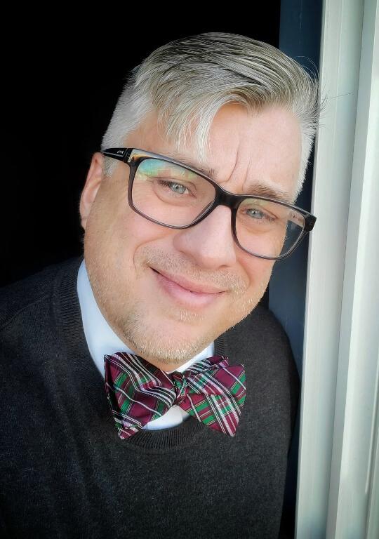 Tim Kubiak wearing plaid bow tie