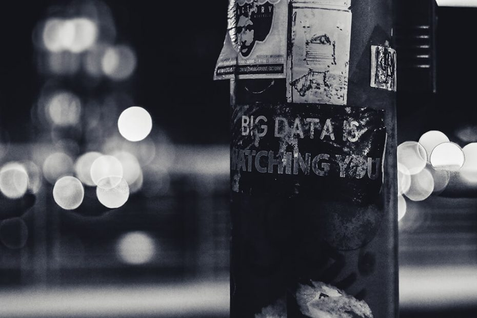 data privacy poster stuck on lamp post with bokeh city lights in background