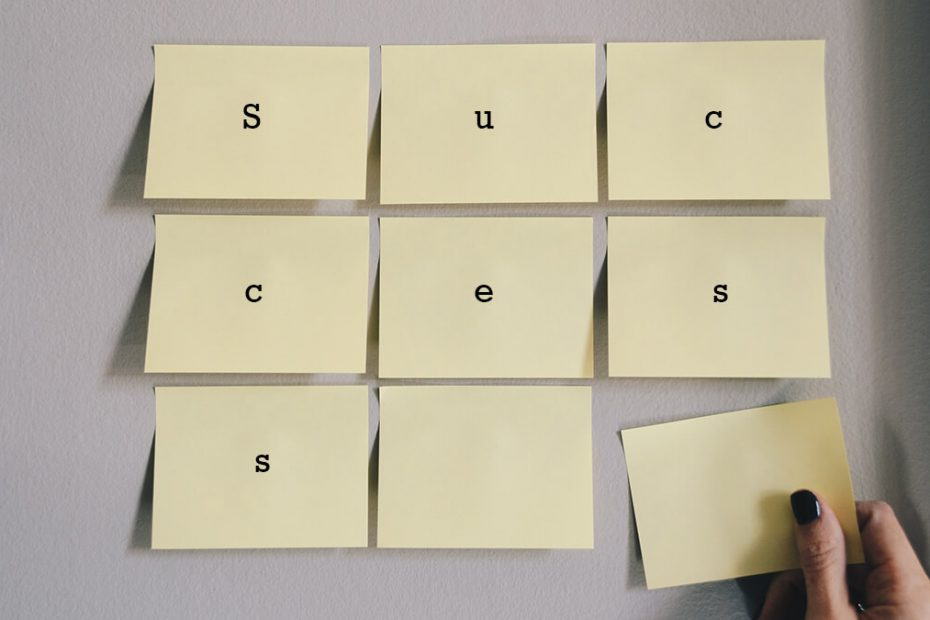 letted spelling out word success of post it notes on the wall for post about tips for success
