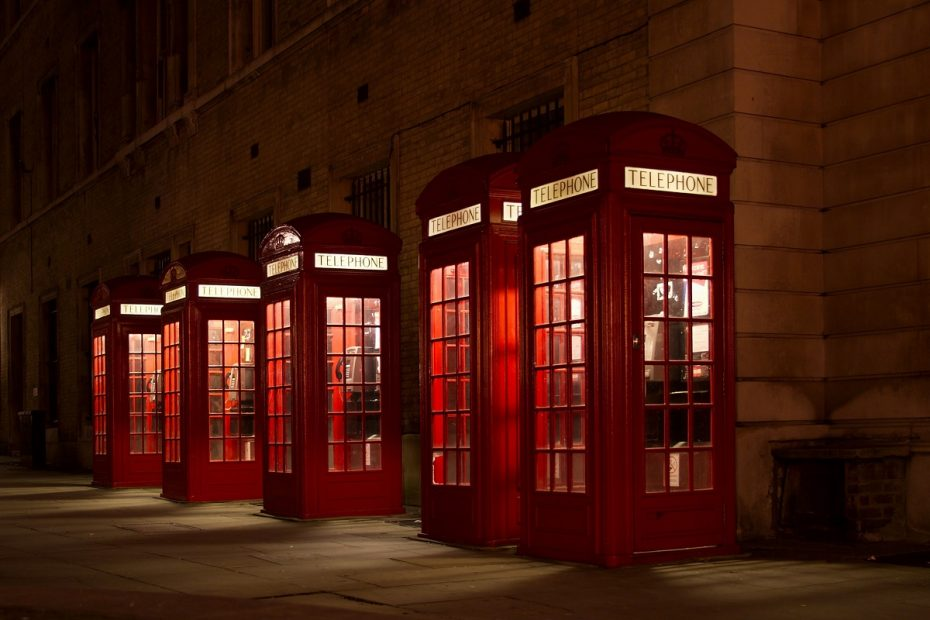 Row of Red British Telecom Phone Booths at night