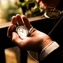 Premier Sales Coaching Program - Pocket Watch in a mans hand