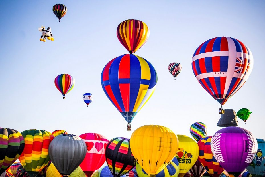 A collection of hot air balloons taking off, meant as a representing services business that takes flight