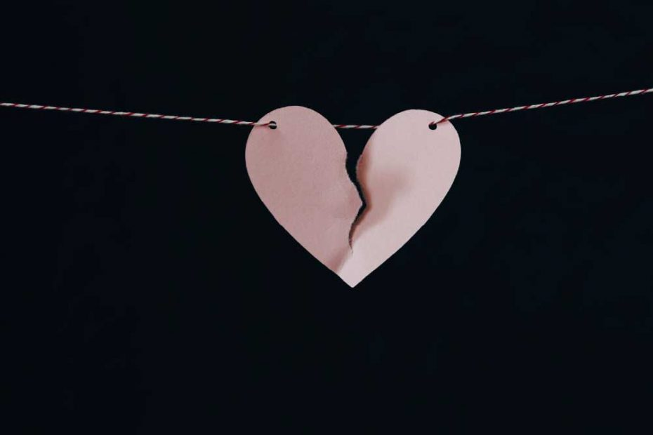 a baby Pink Broken heart on a black background